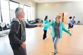 Senior couple take swing dancing lessons