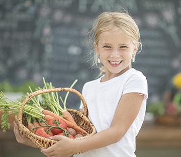 Holding a Basket of Vegetables